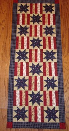Patriotic table runner pattern.  I'm liking table runners, maybe I'll have to try my hand...not as big a time commitment as a whole quilt and you can make a lot of different ones for seasons/holidays.