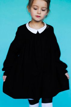 Oooh. I love kids wearing all dark colors, like they're in a Dickens novel or something. Dress by BOdeBO.
