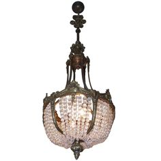 French Gilt Bronze and Crystal Basket Chandelier, Circa 1830 | From a unique collection of antique and modern chandeliers and pendants  at https://www.1stdibs.com/furniture/lighting/chandeliers-pendant-lights/
