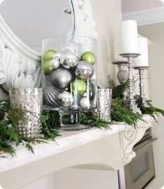 DIY Christmas Decorations! Silver & Green Mantel Decor | http://diyready.com/our-20-favorite-mantel-decorating-ideas-christmas-mantel-decor/