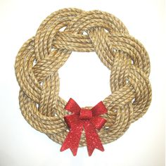 """This rustic manila wreath is made with 1/2"""" manila rope and is about 17"""" across. Leave it hanging all year long; you can keep it plain or dress it up for the holidays. This wreath is unadorned. Be cre"""