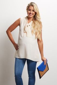 This chic maternity top will become one of your new favorite essentials this season. A stylish tie-neck detail and a flowy chiffon material is perfect from work to date night. Pair this blouse with shorts for a casual look or style with trousers and a statement necklace for the office.