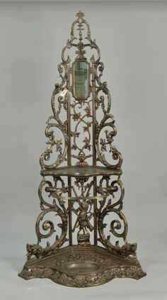 FRENCH ORNATE CAST IRON CORNER HALL TREE; with small mirror and umbrella stand, signed Corneau Alfred Charleville Corner Hall Tree, Vintage Coat Rack, Cast Iron, It Cast, Coat Tree, Hall Stand, Regency Furniture, Small Mirrors, Chandelier