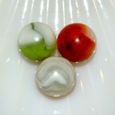 Three Antique Marbles All Manufactured By The Vitro Agate Company A Nice Mix Of Colors Here Green White Orange And Cherry Red