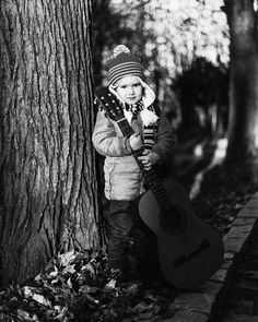 Guitar boy #street #streetphotography #boy #kid #guitar #blackandwhitephotography #b&w #bnw