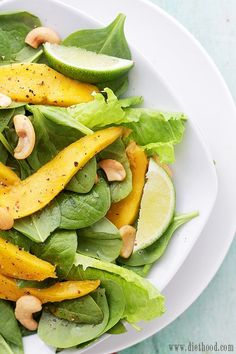 Mango Spinach Salad with Honey Lime Dressing | www.diethood.com | Baby Spinach leaves tossed with slices of fresh mango, cashews, and a homemade Honey Lime Dressing. | #recipes #salad #spinachsalad