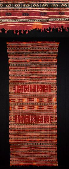 Africa | Mushtia shawl is from Jbiniana, a village between Sfax and Mediha, in Tunisia. | Spots of orange henna accent the complex bands of white, black and red wool.| Early to mid-20th century.