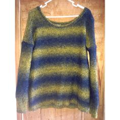 Oversized Urban Outfitters Sweater Cute distressed looking oversized sweater from Urban Outfitters. In good condition and looking for a new home. In person the colors look more mustard and black instead of mustard and blue! Urban Outfitters Sweaters Crew & Scoop Necks