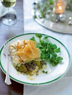 Sweet caramelised leeks go beautifully with rich creamy cheese and buttery pastry to make this vegetarian main course perfect for a special occasion.