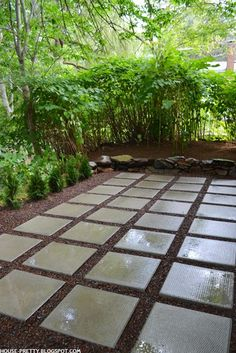 Gravel rock patio with pavers. Add some bushes around the perimeter