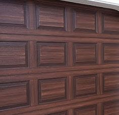 Faux wood doors one project a weekend wrought iron for Painting garage door to look like wood