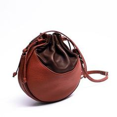 .two brown shades round leather bag