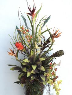 Bird of paradise arrangement designed by Arcadia Floral & Home Decor.