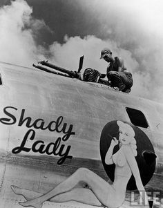 "B-29 ""Shady Lady""  Ground crew member adjusting machine guns on a B-29 Superfortress named ""Shady Lady"" from the 497th Bomb Group.  Saipan,Marianas Islands;1945."