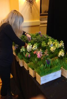 Lauren Fox, President of Fox Events based out of Charleston, SC gets hands on making final adjustments to some centerpieces for one of her favorite corporate clients at Wild Dunes Resort.