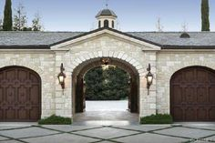 Motor Court entrance Porte-Cochere with wooden gates to compliment the wood garage doors