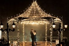 I have seen this done several times at weddings. Borrow someones metal gazebo and string with lights and tulle for a fantastic addition to the dance floor.