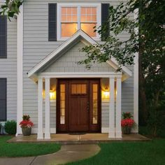 Isn't this entry gorgeous? Here we explain the differences between slab and pre-hung fiberglass doors: costs, durability and where to buy. | Photo: Courtesy of Clopay | thisoldhouse.com