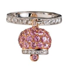 Anello in oro bianco e rosa, diamanti e pavé di zaffiri rosa