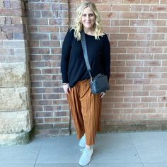 Casual outfit - long sleeve top, pleated pants and sneakers | For more style inspiration visit 40plusstyle.com