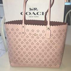 Coach City Tote laser cut flowers Probably the cutest bag I've seen from coach! Laser cut flowers are adorable for spring and summer. A light glittery pink leather is gorgeous and eye catching. It has 3 inside pockets on sides and 1 pocket with a zip. Perfect to throw everything in and go!Ⓜ️205! Coach Bags Totes