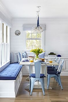 Try carving out a dining nook: Station your dining table in an unused corner, then employ built-in benches on two sides for a casual seating setup. Cushions in durable Sunbrella fabric make cleaning up sand and salt a breeze. Click through for more home decor inspiration from this beautiful and beachy New Jersey home.