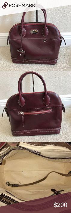 """Dooney & Bourke Florentine Toscana Domed Satchel Preown in good condition color Bordeaux. Left side strap holder button missing. Very lil scratches and scuff make on purse. Two pen marks inside purse. Comes with dust bag and strap Measures approximately 12""""W x 10-1/2""""H x 6""""D with a 5"""" handle drop and a 15"""" to 24"""" strap drop; weighs approximately 2 lbs, 2 oz Body/trim/lining 100% leather; pockets 100% nylon Dooney & Bourke Bags Satchels"""