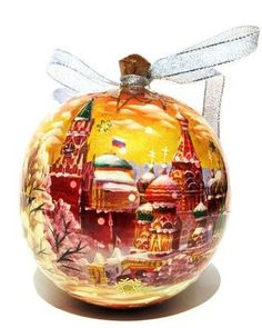 Large ball shaped Christmas tree ornament features Moscow sights in sepia opens up as a keepsake box for hiding messages, treats and holiday surprises.