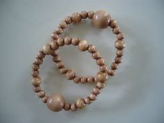"Queasy Beads Motion Sickness Bracelets in ""Toffee"" by QueasyBeads, $19.95"