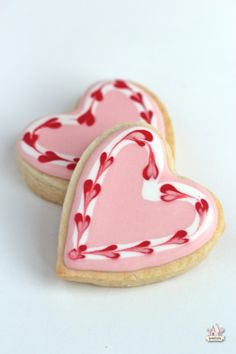 Valentine's Day decorated heart cookies. Royal icing pink, white, red. Marbled.