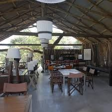 The bar area is spacious and simply designed, yet with style. Elephant Camp, Bar Areas, Al Fresco Dining, Swimming Pools, Camping, Traditional, Table, Outdoor, Furniture