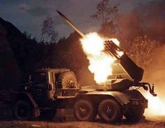 An Indian BM-21 multi-barrel rocket launcher mortar firing at Tiger Hill in the 1999 Kargil War