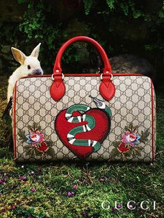 d2e34c465bf Discover more gifts from the Gucci Garden. A limited edition top handle bag  crafted in GG motif and appliquéd with a heart