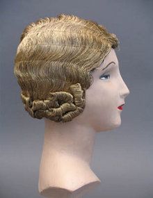 1920s gold thread wig what an era, really cool clothes and really really severe hairdos