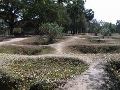 Photo of the excavation pits at the Killing Fields in Cambodia