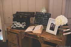 Vintage guest book table with typewriter at Strawberry Farms Wedding with Orange Owl Photo and Found Vintage Rentals