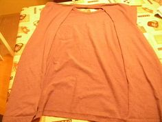 DIY nursing cover...cut the back out of a XL or XXL t-shirt. Cut off the sleeves and sew at the seams.