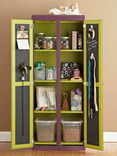 Create a DIY Pet Armoire or Cabinet  This idea is great for small spaces or if you're short on space. Re-purpose an old armoire, cabinet or entertainment unit by treating it to some colorful new paint! I love the idea of using chalkboard paint on the inside of the doors to help stay organized!