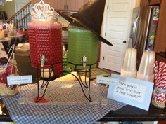Punch station for Wizard of Oz Bridal Shower/Party. Wicked Witch punch in green with a black witches hat on top and Glinda Good Witch punch in pink with tiara on top!