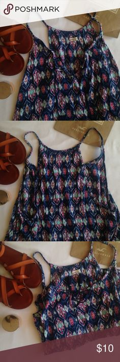 Floral Hollister Tank Talk about adorable. These colors just all flow and look great together. Brown sandals bring out the shirts colors. Flattering back. In great condition and super trendy. Pretty loose so looks great with bandeau or bralette. Could fit small. Hollister Tops Crop Tops