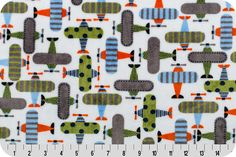 So many whimsical airplanes on this cute Cuddle fabric. RKC Take Off Cuddle® Kiwi This soft and plush cuddle print features high flying bi-planes decorated in valiant stripes and dots on a field of Snow. These planes are decorated in Graphite, Sky, Navy, Black, Mandarin, and Kiwi. Take Off, by Anne Kelle, a Robert Kaufman Cuddle print for Shannon Fabrics. @annkelle