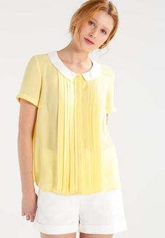 """Shirt - pale banana. Sheer:semi-sheer. Details:bust darts. Neckline:round neck. Sleeve length:short. Our model's height:Our model is 69.5 """" tall and is wearing size 8. Outer fabric material:100% polyester. Fastening:bu..."""