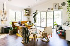 A Bright, Happy, Family Home...in a Backyard Shed. Shelves, art above sliding glass door etc.