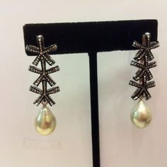 A pair of silvery grey south sea pearl earrings customized for my client