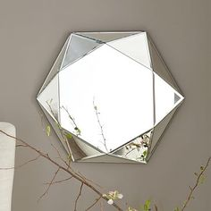 Faceted Mirror - Small. A mirrored work of art. Our deco-inspired Faceted Mirror features six mirrored facets to help reflect more light, making it perfect for creating the illusion of space in smaller rooms, corners and hallways.