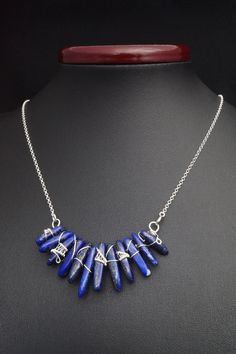 A unique, delicate, handmade, wire wrapped Sterling silver necklace with Lapis Lazuli stones.  necklace was designed and made by Me, using an extremely labor-intensive and precise wire-wrapping technique, with sterling silver 925, 930 and 999. Dimensions of pendant: length: 6,7 cm 2.63 inch hight: 3,2 cm 1.25 inch  You receive this unique necklace in jewelry box, so it is ready to be a gift.  -------------On this auction You buy pendant with chain ( 17.71 inch ).---------------   Refunds…