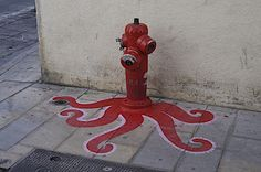 Urban Octopus. Street art: I like this image for a possible journal topic. Write the story of this octopus.