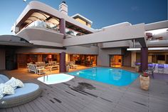 This is definitely a work of art!  (www.rawson.co.za/property/4-bedroom-house-for-sale-in-helderkruin-view-id-573163)