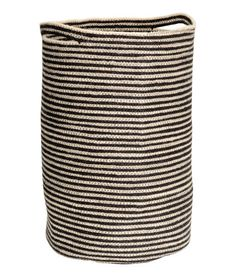 Light beige/striped. Jute laundry basket with two handles. Diameter approx. 12 1/2 in., height 20 1/2 in.