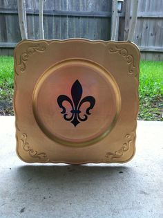 Fleur de lis Charger.  Can also be done with last name and est. at the bottom.  www.facebook.com/pages/Sassy-Decor-and-More-LLC/365352106761